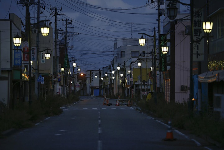 Street lamps light the street in the evacuated town of Namie in Fukushima prefecture