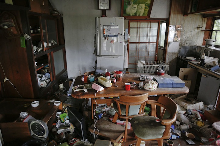 A clock shows the time of 2011 earthquake at the kitchen of a damaged house in the evacuated town of Namie in Fukushima prefecture