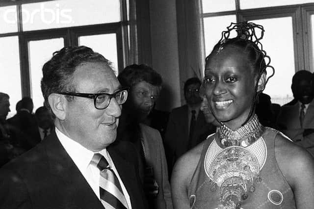 Henry A. Kissinger Chatting with Elizabeth Bagaaya