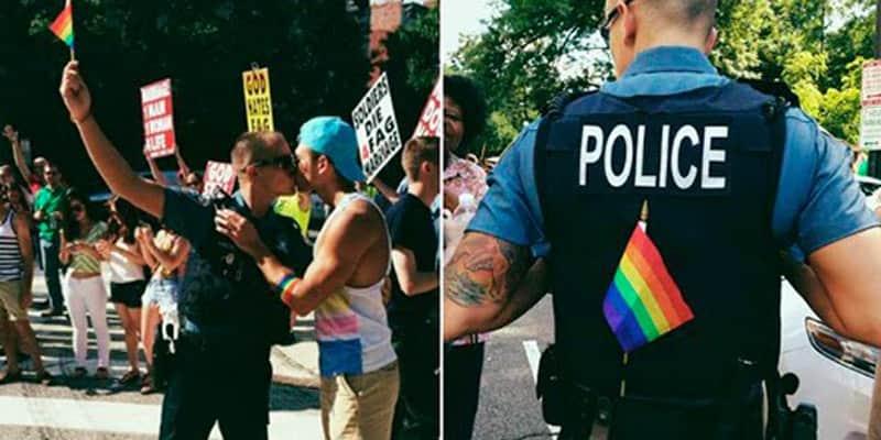 Policial beija namorado durante protesto de religiosos contra homossexuais nos EUA 5
