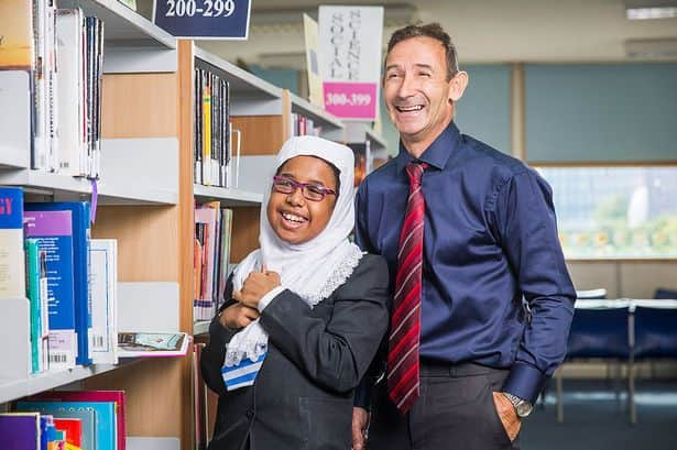 POB-2014-Teacher-of-the-Year-Nominee-Ray-Coe-with-pupil-Alya-Ahmed