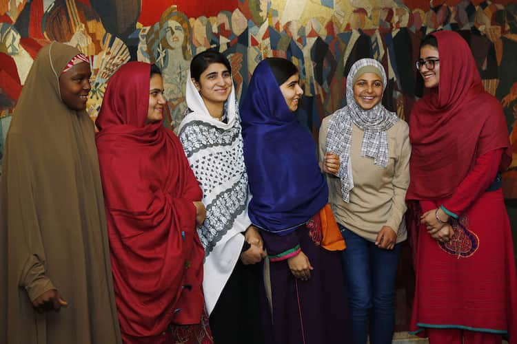 Nobel Peace Prize laureate Yousafzai greets young women activists who she invited to accompany her, in Oslo