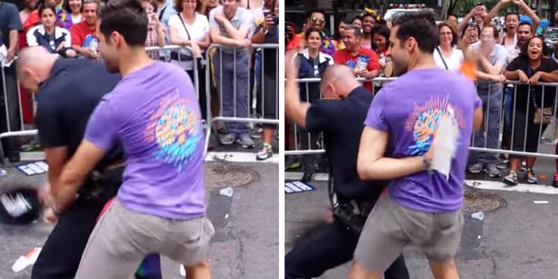 Policial dança até o chão com participante da Parada Gay em NY 2