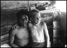 Steve Saint as a boy with one of the Waodani warriors, Kimo. Credit tk