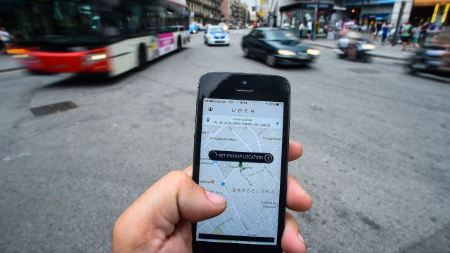 BARCELONA, SPAIN - JULY 01:  In this photo illustration the new smart phone taxi app 'Uber' shows how to select a pick up location on July 1, 2014 in Barcelona, Spain. Taxi drivers in various cities have been on strike over unlicensed car-hailing services. Drivers say that there is a lack of regulation behind the new app.  (Photo by David Ramos/Getty Images)