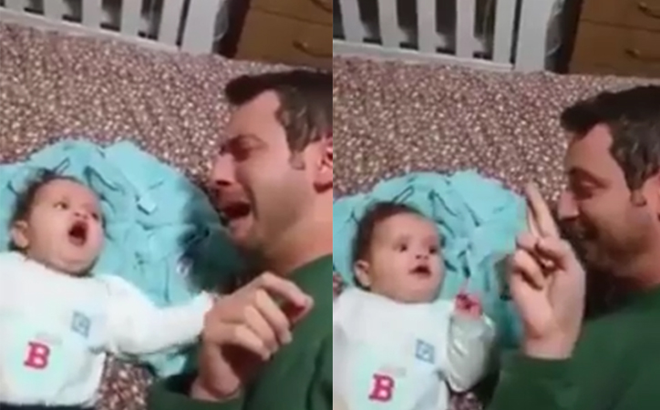 Bebê presta atenção e para de chorar quando pai faz língua de sinais 1