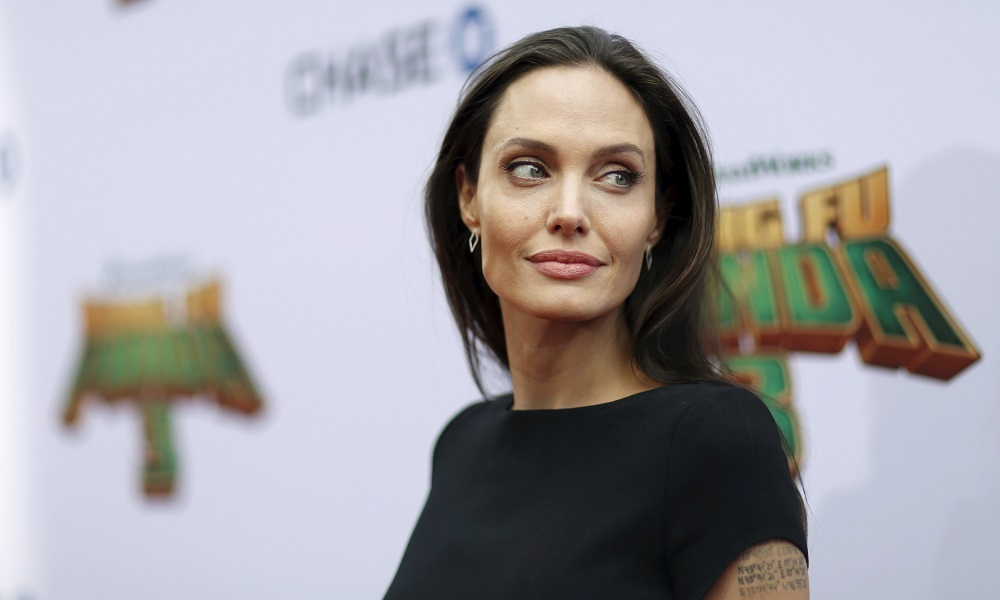 """Jolie poses at the premiere of """"Kung Fu Panda 3"""" at the TCL Chinese theatre in Hollywood"""
