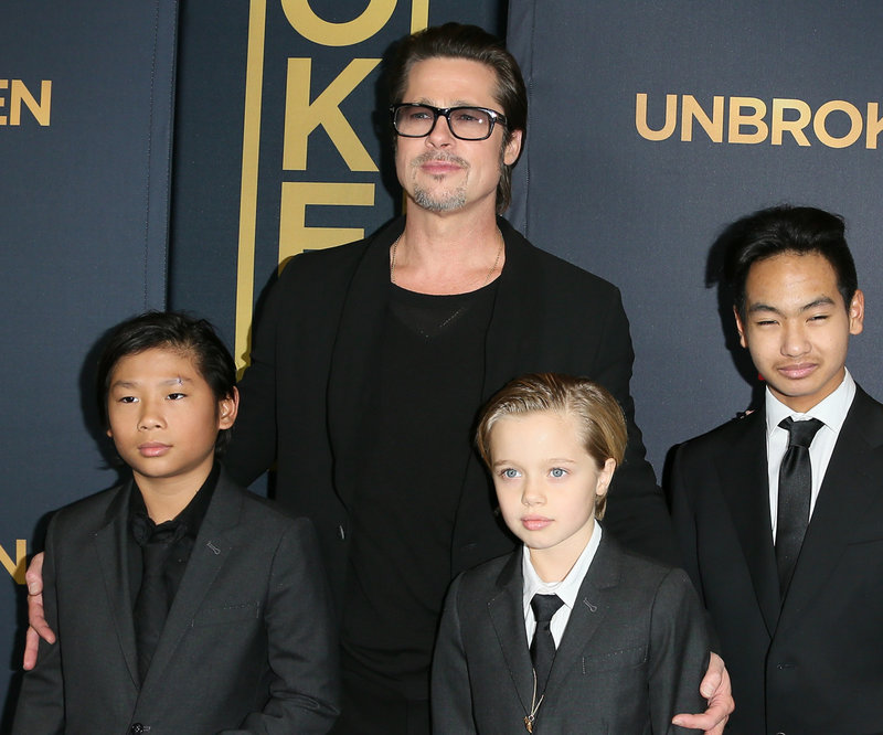 """HOLLYWOOD, CA - DECEMBER 15: Brad Pitt; Pax Thien Jolie-Pitt, Shiloh Nouvel Jolie-Pitt and Maddox Jolie-Pitt attend the """"Unbroken"""" Los Angeles premiere held at the TCL Chinese Theatre IMAX on December 15, 2014 in Hollywood, California. (Photo by JB Lacroix/WireImage)"""