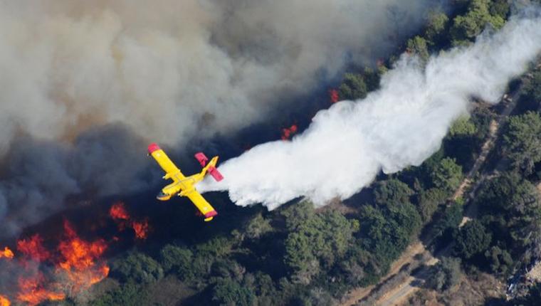 Bombeiros palestinos ajudam a combater incêndios florestais em Israel 2