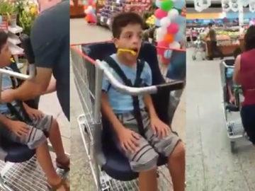 menino com necessidades especiais ganha carrinho de compras adaptado
