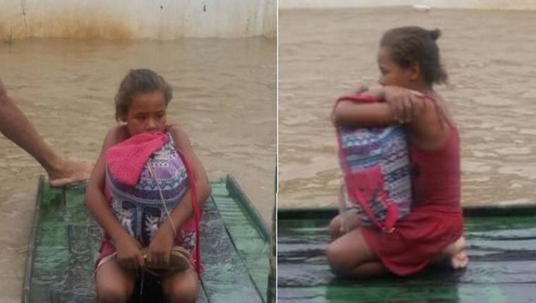 Resultado de imagem para criança salva livros da enchente