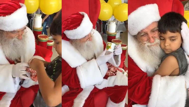 Criança dá presente para Papai Noel que se emociona com a surpresa 3