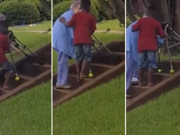 garoto ajuda idosa subir escada
