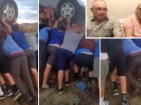 time de futebol resgata casal carro capotado