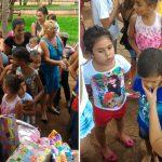 menina distribui brinquedos crianças carentes dia crianças