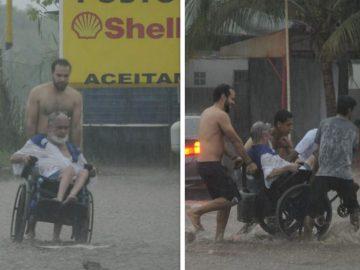 Em meio a chuva, jovens ajudam cadeirante a atravessar a rua 1