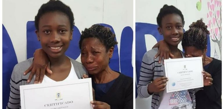 Foto de mãe chorando após conquista de filha na escola emociona