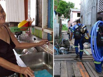 funcionários empresa saneamento básico levam água potável famílias moram palafitas