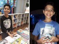 menino em livraria folheando livro