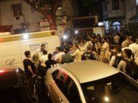 médicos curiosos e ambulancias se aglomeram em torno do hospital badim