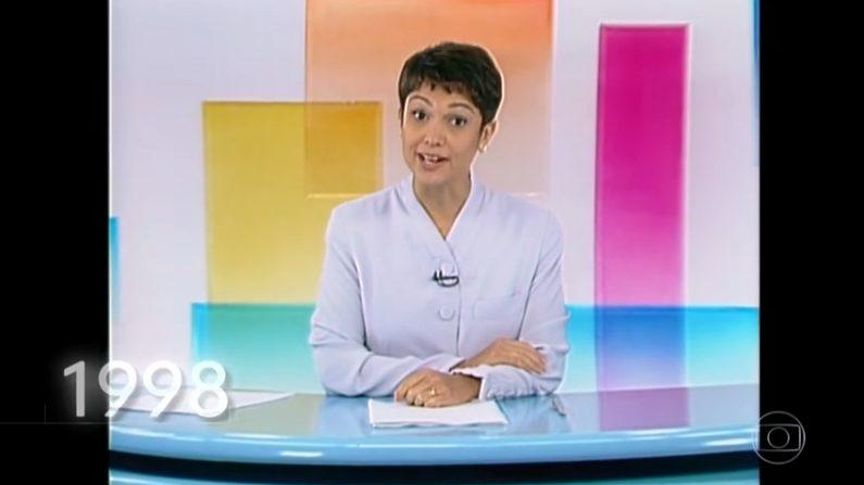 Na despedida do Jornal Hoje, Sandra Annenberg recebe homenagem no formato de retrospectiva. Sandra Annenberg apresentando o Jornal Hoje em 1998