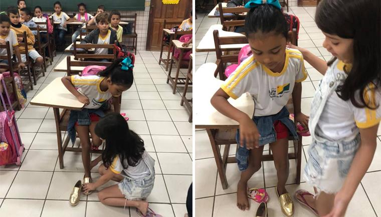 Aluna doa sapato e se ajoelha para calçar pés da coleguinha 1