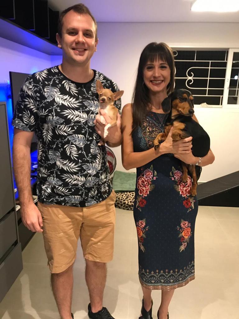 cãozinho adotado pet shop xodó família