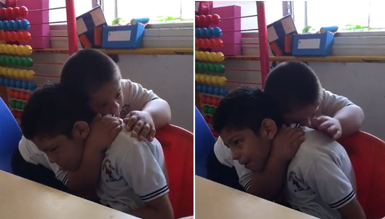 Menino com síndrome Down dá carinho e acalma colega autista; assista 3