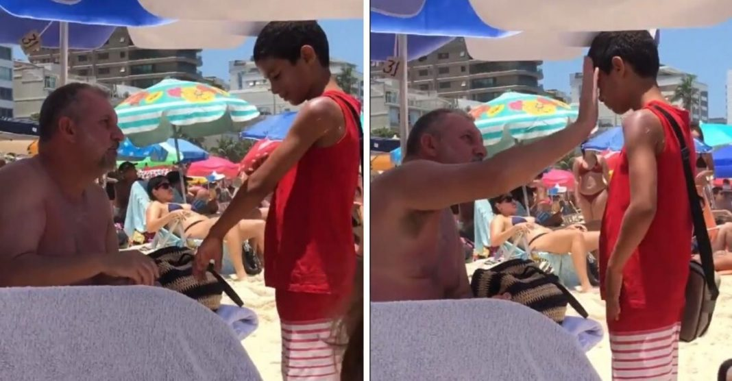 Homem passa protetor solar em menino que vendia bala na praia e atitude viraliza