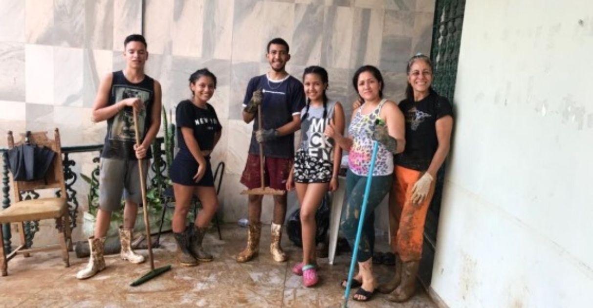 Refugiados da Venezuela ajudam população mineira chuvas