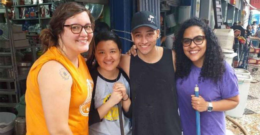 Estrangeiros voluntariam ajudar limpeza Mercado Central BH