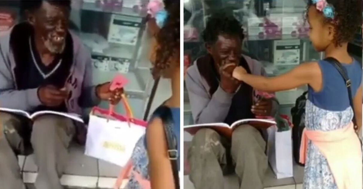 Menina aniversariante leva pedaço de bolo para sem-teto