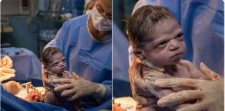foto bebê faz cara de brava após o parto