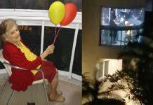 Vovó arruamada e com balões na sacada de prédio