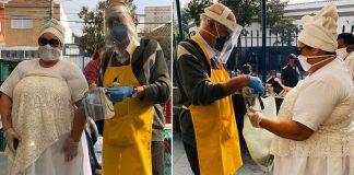 padre e mãe de santo distribuindo alimento moradores de rua