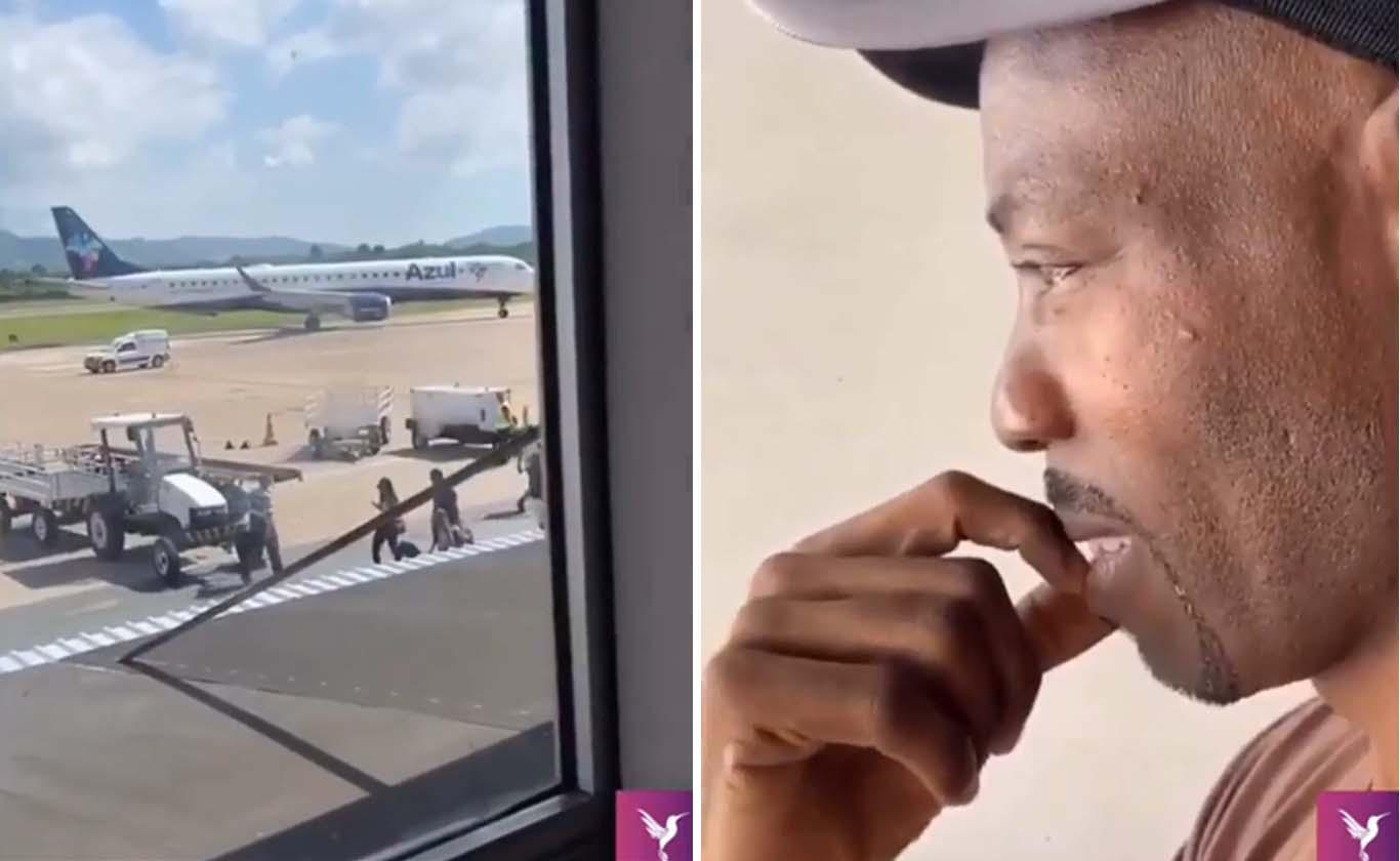 haitiano olha janela aeroporto aguardando chegada família brasil