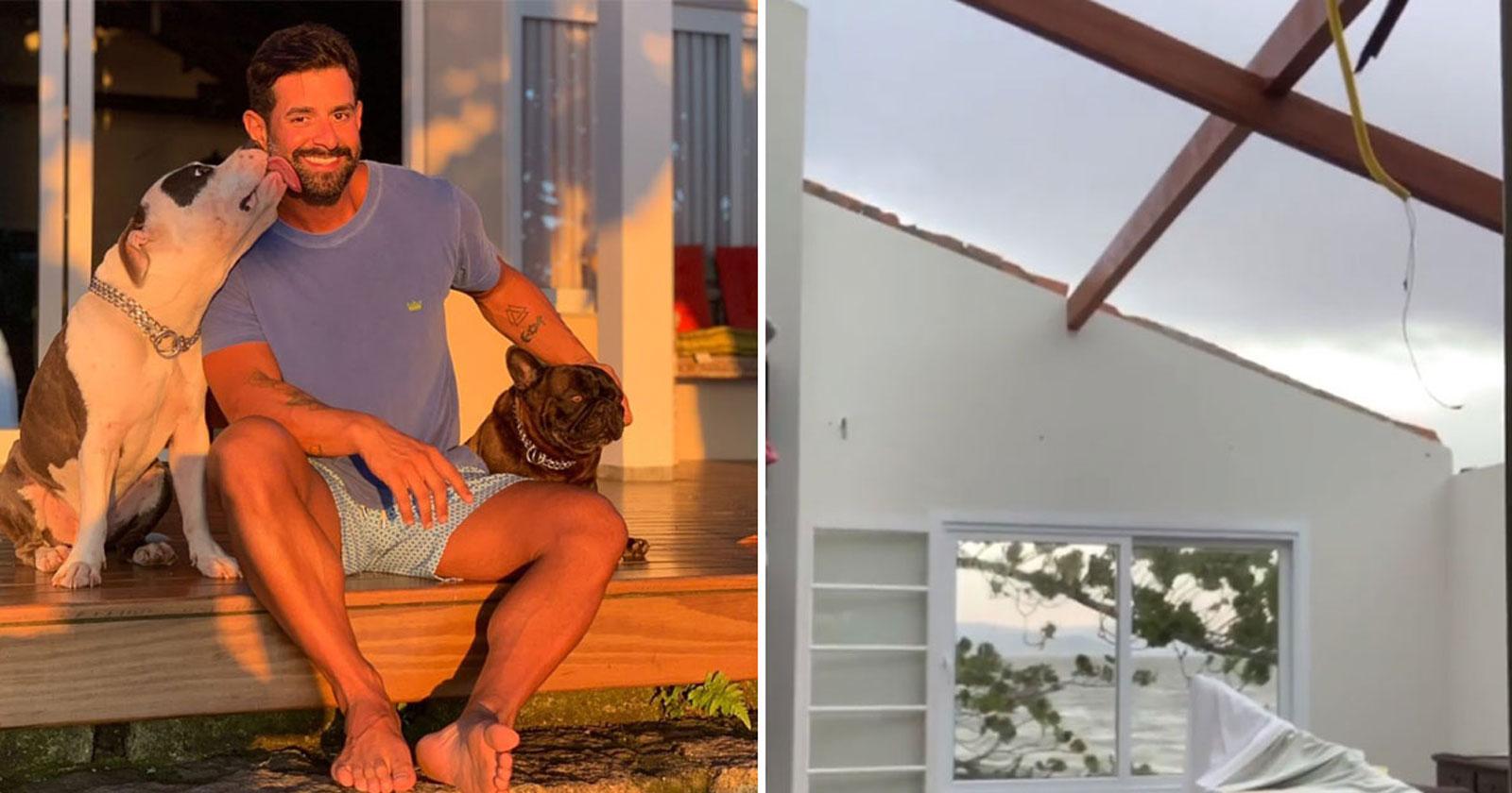 homem sorrindo sentado varanda casa cercado dois cachorros