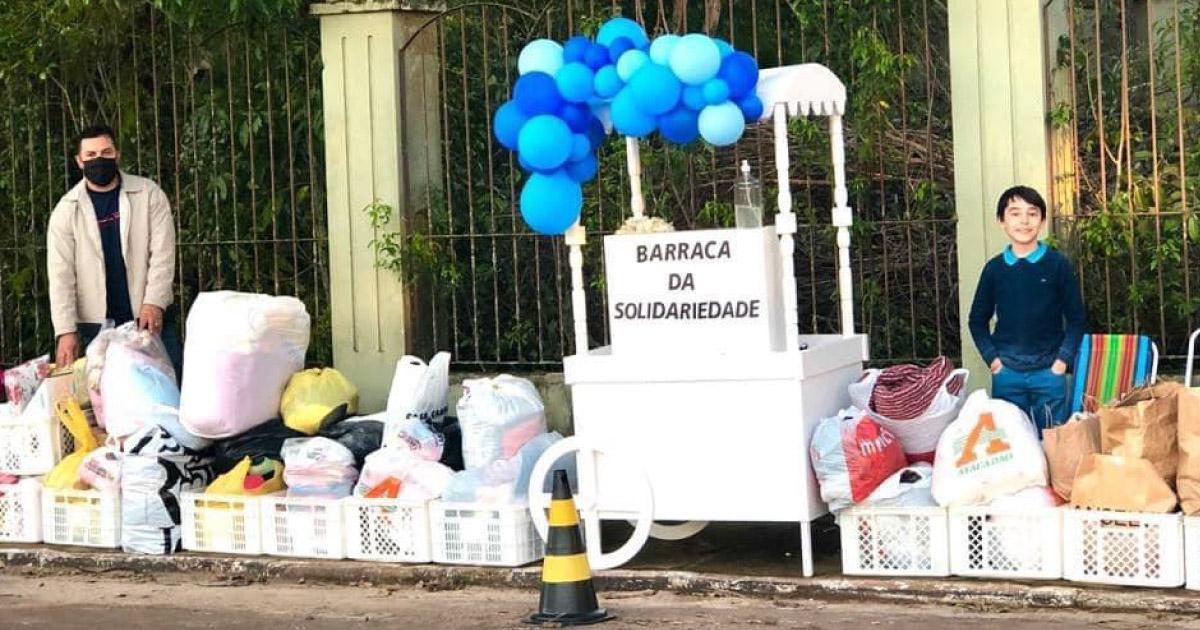 """Menino de 8 anos cria """"Barraca da Solidariedade"""" e recolhe donativos para vitimas das enchentes no RS 1"""