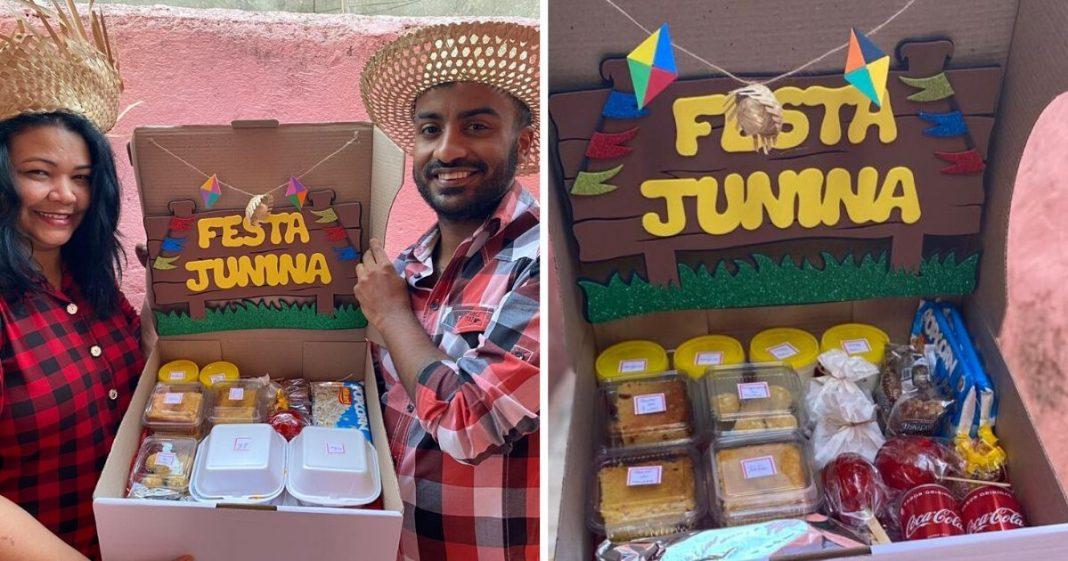 Homem e mulher de camisa xadrez e chapéu segurando caixa com artigos de festa junina