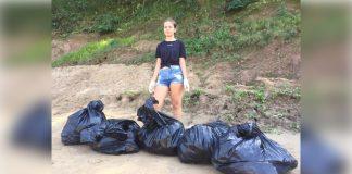 sharon com sacos de lixo