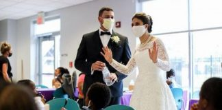 casal doa comida festa de casamento abrigo mulheres