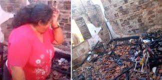 mulher chora olhando casa destruída incêndio