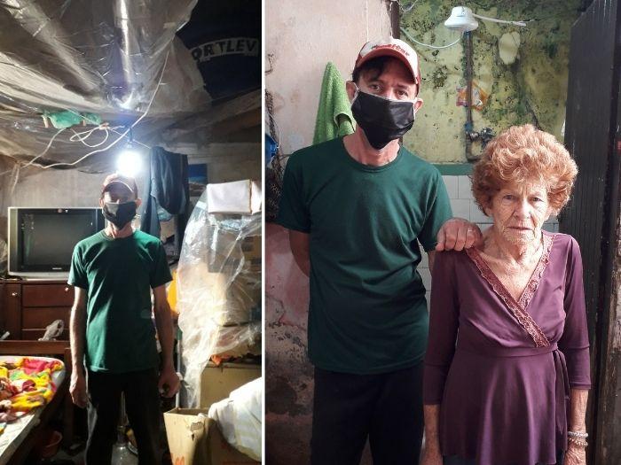 homem com a mãe em casa que perdeu em enchente