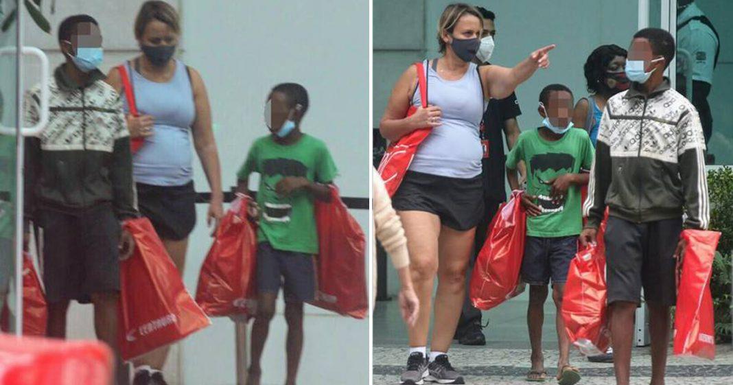 Atriz Giulia Gam leva meninos que vendem bala para shopping, compra presentes e se emociona 2
