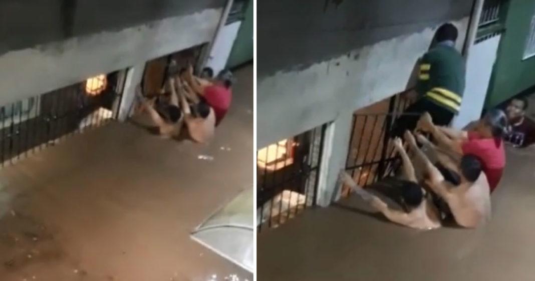 Moradores se unem para salvar vizinho que se afogaria em enchente 3