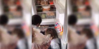 mãe enche geladeira doações