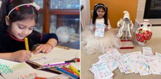 Menina desenhando em mesa com lápis de cor e menina sentada ao lado de boneco do Papai Noel e vaso e centenas de cartões desenhados