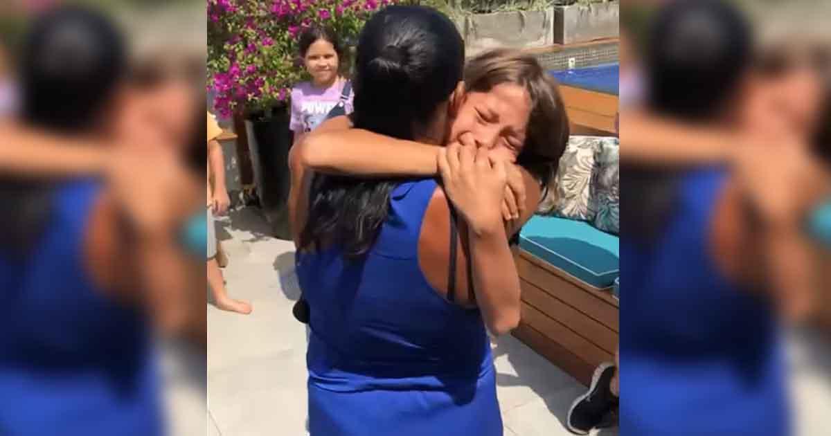 menino abraça babá aniversário
