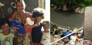 Família em casa feita de madeira na beira do rio