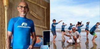 Professor de surf com alunos na beira do mar